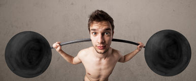 Funny skinny guy lifting weights Stock Image