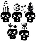 Funny skulls with flowers. Stock Image