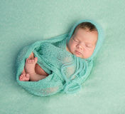 Funny sleeping newborn on blue blanket and in diaper Royalty Free Stock Photo