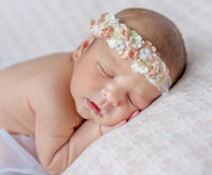 Funny sleeping newborn girl with her hands under head Stock Image