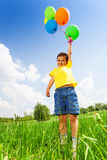 Funny small boy with colorful balloons Stock Photos