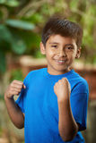 Funny small boy showing muscle Stock Image