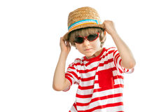 Funny small boy with sunglasses and straw hat Stock Photos
