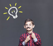 Funny smart kid. With fake mustache. New ideas creativity concept stock image