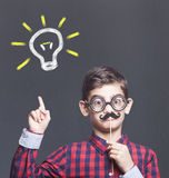 Funny smart kid. With fake mustache. New ideas creativity concept royalty free stock photo