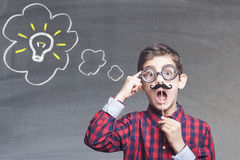 Funny smart kid. With fake mustache. New ideas creativity concept stock photos