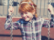 Funny and smart little girl portrait Stock Image