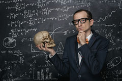 Funny smart nerd. Against chalkboard with many math formulas stock image