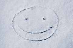 Funny smile face. On snow Royalty Free Stock Photos