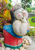 Funny smile lady  sculpture. In the garden Royalty Free Stock Photography