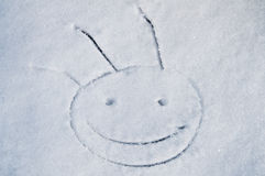 Funny smile on snow. Funny smile face on snow Stock Images