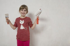 Funny smile young girl with paint-brush. Stock Image