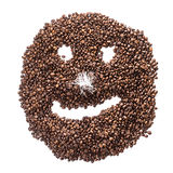Funny smiley of coffee beans with a nose from tinsel isolated on white background.  Stock Photography