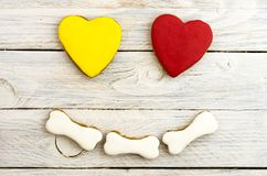 Funny Smiley. A dog loves bones. The dog wants to eat. White, red and yellow Stock Image