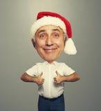 Funny smiley senior man in red santa hat Stock Image