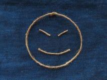 Funny smiley of twine in denim. Emoji sign handmade icon.  royalty free stock photo