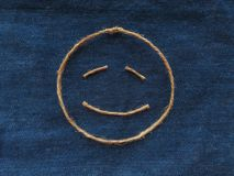 Funny smiley of twine in denim. Emoji sign handmade icon.  stock images