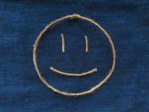 Funny smiley of twine in denim. Emoji sign handmade icon.  stock photos