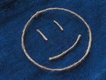 Funny smiley of twine in denim. Emoji sign handmade icon.  stock image