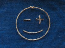Funny smiley of twine in denim. Emoji sign handmade icon.  royalty free stock photography