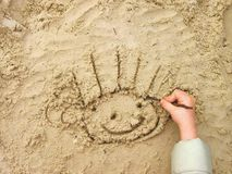Funny smiley on wet sand Royalty Free Stock Photography