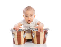 Funny smiling baby with bongos Royalty Free Stock Images