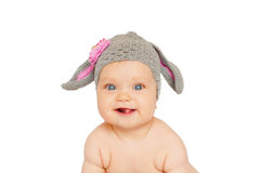 Funny smiling baby like easter bunny or lamb. Stock Photos