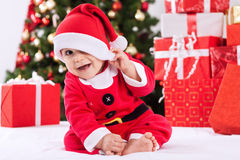 Funny smiling baby santa claus Stock Images