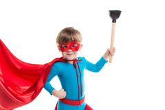 Funny smiling boy playing a superhero. royalty free stock photo