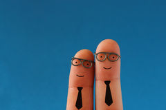 Funny smiling business men. Two smiling business men - succesful teamwork - funny finger people Royalty Free Stock Images