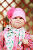 Funny smiling Caucasian baby girl in pink Royalty Free Stock Photos