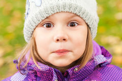 Funny smiling Caucasian little girl, close up Stock Photos