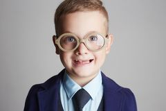 Funny smiling child in glasses and siut Stock Photo