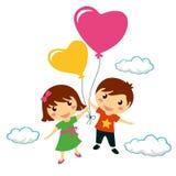 Funny smiling children holding heart balloons Stock Images