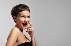 Funny smiling curious woman wearing red lips Stock Image