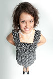 Funny smiling curly beauty!. Top view to the pretty girl wearing spotted dress Stock Images