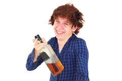 Funny smiling drunk man. Holding bottle of whiskey and cigarette Stock Image