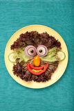 Funny smiling face made of vegetables Stock Photography