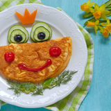 Funny smiling frog princess omelette Stock Photo
