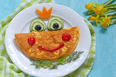 Funny smiling frog princess omelette Royalty Free Stock Image