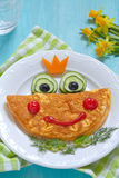 Funny smiling frog princess omelette royalty free stock photography