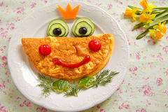 Funny smiling frog princess omelette Royalty Free Stock Photo