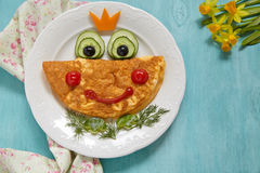 Funny smiling frog princess omelette stock images