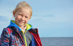 Funny smiling girl on the beach Royalty Free Stock Image