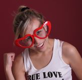 Funny smiling girl in red head glasses Stock Image