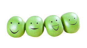 Funny smiling green peas Stock Image