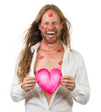 Funny Smiling Hippie Man Covered In Red Kisses Royalty Free Stock Photos