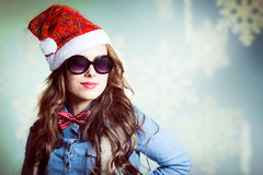 Funny smiling hipster girl in sunglasses wearing Royalty Free Stock Photography