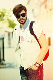 Funny smiling hipster handsome man in hipster cloth in the street Royalty Free Stock Photography