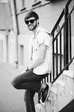 Funny smiling hipster handsome man in hipster cloth in the street Stock Photo